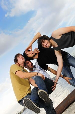 Portrait of young trendy team of male friends having fun outdoors Stock Photo