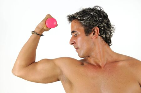 Portrait of young muscular hispanic man holding dumbell photo