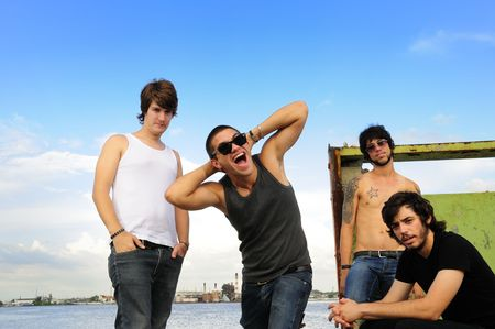 Portrait of cool team of young friends posing outdoors Stock Photo