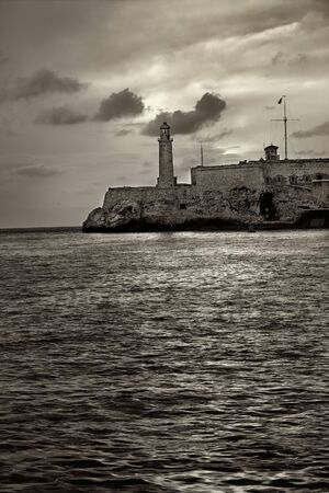 habana: Sepia toned image of el Morro fortress in havana bay