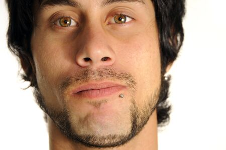 Portrait of young latino man with face piercing - isolated photo