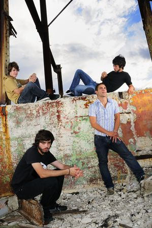 Portrait of young trendy team of male friends posing on grunge background Stock Photo - 5395911