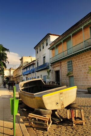 A view of typical architecture with old boat in Old havana street, cuba Stock Photo - 5398273