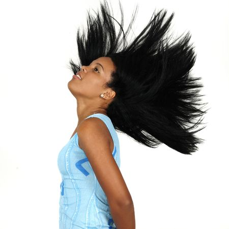 Portrait of young african american girl waving her hair - isolated photo