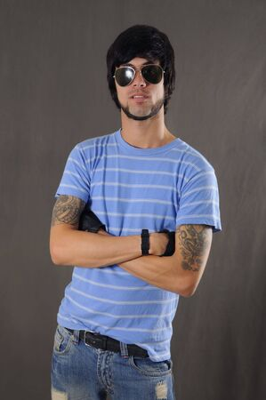 arm tattoo: Portrait of cool young guy with arm tattoo and sunglasses