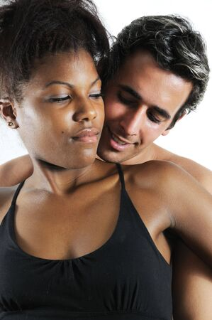 Portrait of young latin multiracial couple embracing photo