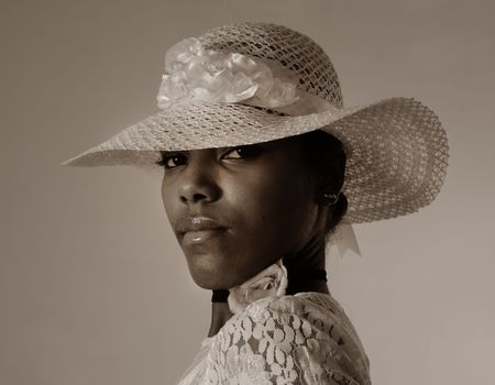 hat nude: Sepia toned portrait of young african american female model wearing a hat