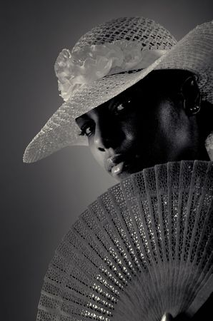 Black and white portrait of beautiful african american fashion woman wearing hat