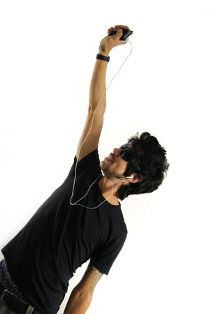 Cool handsome hispanic man listening to music with headphones - isolated photo