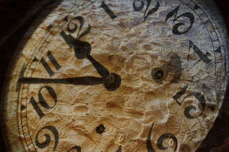 Mixed media image of vintage clock numbers over footsteps in the sand - concept regarding the passage of time