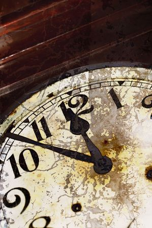 erode: Detail of vintage clock with cracks on the surface  Stock Photo