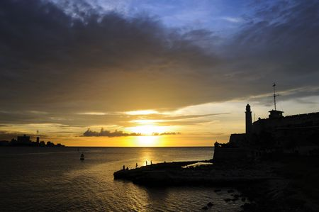 A view of el morro fortress silhouette in Havana bay entrance at sunset