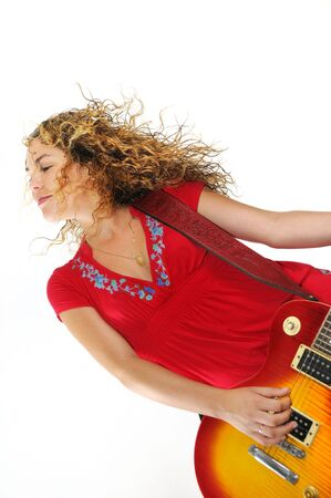 Portrait of young blond trendy woman playing electric guitar isolated photo