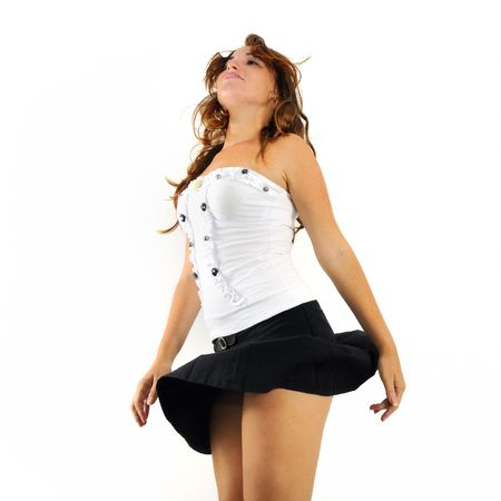 Portrait of young beautiful trendy woman dancing isolated photo