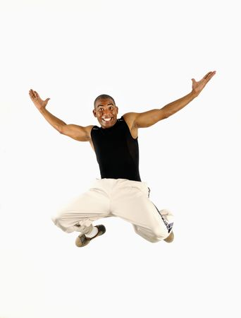 Portrait of young cheerful african american man jumping isolated  photo