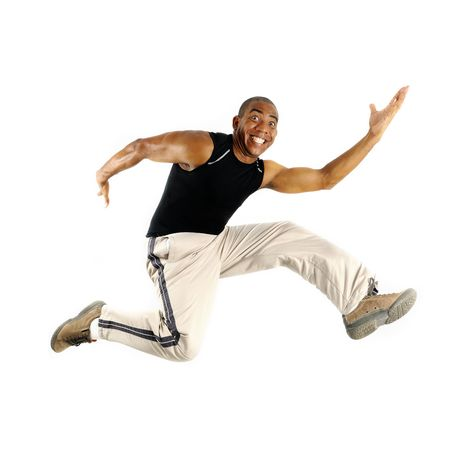 Portrait of young cheerful african american man jumping isolated Imagens - 5768052