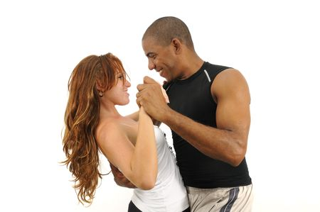 Portrait of young multiracial couple dancing isolated on white Stock Photo