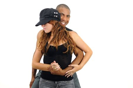 Portrait of young african hispanic man embracing caucasian girl in dancing pose - isolated on white