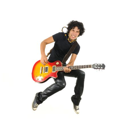Portrait of young trendy guy jumping with electric guitar isolated on white photo