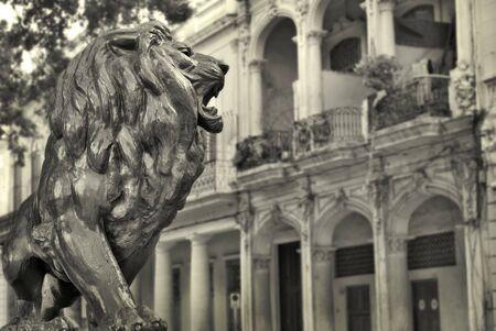 habana: Detail of Lion metal statue and buildings in el Prado, Habana, cuba.