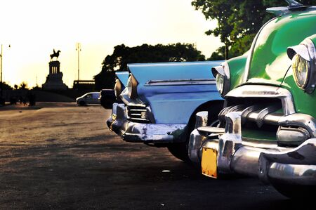 A view of havana city with vintage american cars detail and monument in the background Banco de Imagens