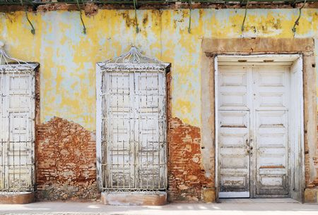 crumbling: Detail of eroded house facade in vintage town trinidad, cuba