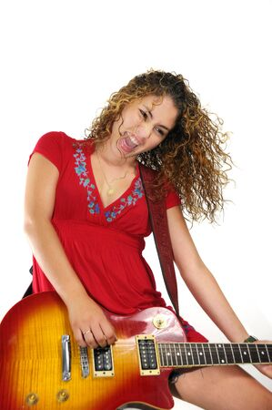 Portrait of young trendy girl screaming and playing guitar isolated on white photo
