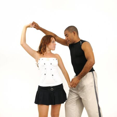 dance teacher: Portrait of young multiracial couple dancing isolated on white Stock Photo