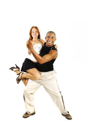 coordinacion: Retrato de una joven pareja de baile, instructora de baile latino llevando a chica - aislada
