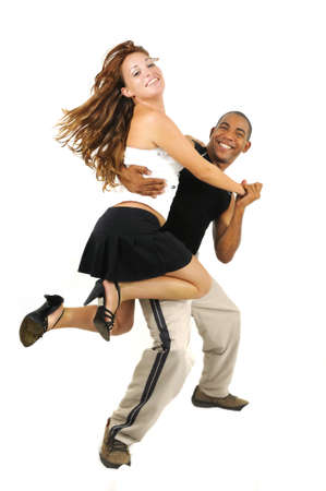 Portrait of young couple dancing, latino dance instructor carrying girl - isolated photo