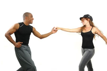 Portrait of young multiracial couple dancing isolated on white photo