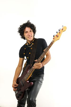 Portrait of young trendy man playing electric bass guitar isolated