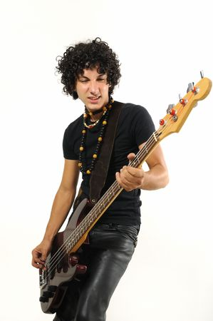 Portrait of young trendy man playing electric bass guitar isolated photo