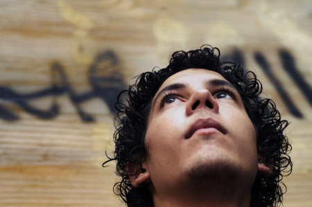 Portrait of young hispanic teen boy against grunge background Banque d'images