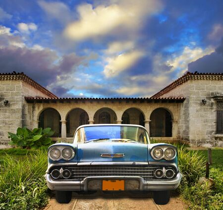 Front view in vintage american car parked in tropical residence, cuba Stock Photo - 6350097