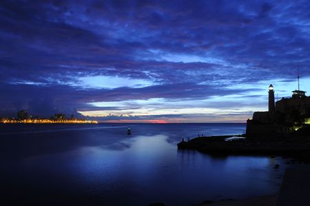 fortress: El Morro lighthouse and havana bay at dusk Stock Photo