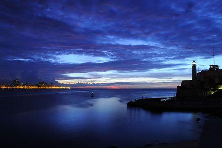 El Morro lighthouse and havana bay at dusk Banque d'images