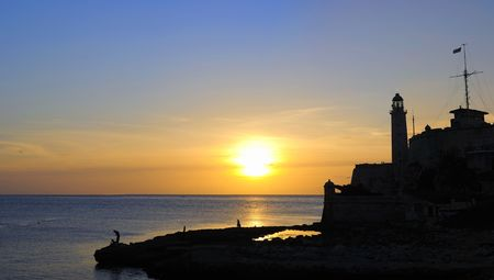 Panoramic view of Morro fortress silhouette at sunset in havana, cuba Stock Photo - 6350085