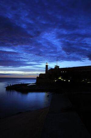 El Morro lighthouse and havana bay at dusk Stock Photo - 6665659
