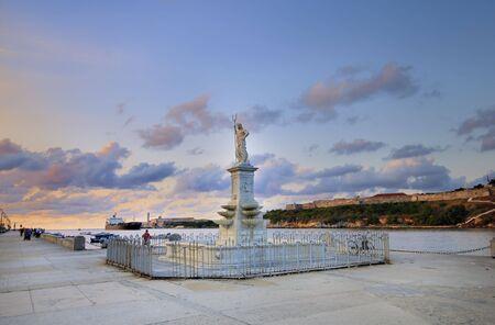 Neptune statue in havana bay entrance against sunset sky photo