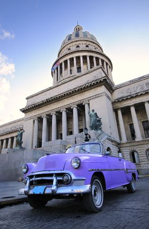 Old classic american car and Capitol building in havana city