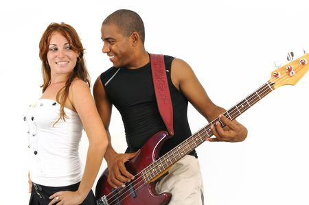 Portrait of young multiracial couple of man playing bass guitar and girl isolated on white photo