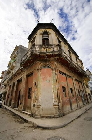 Corner in Havana street with eroded building facade against blue sky, cuba Stock Photo - 6400772