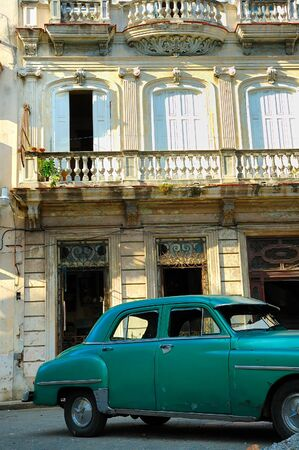 Detail of vintage classic car parked in shabby Old Havana street photo