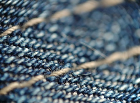 Abstract macro background of a piece of blue denim photo