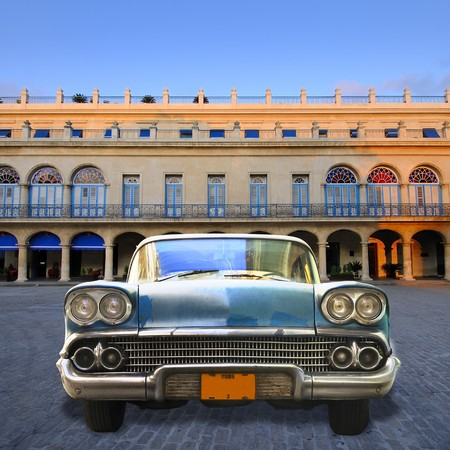 Front view of vintage classic american car parked in Havana plaza, cuba
