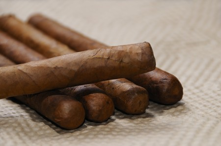 Bunch of typical handmade cuban cigars with soft focus photo