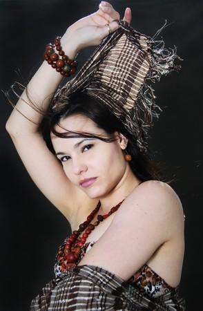 Portrait of young beautiful fashion woman wearing scarf photo