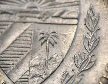 Macro shot of cuban currency detail - coin of 20 cents - depicting the national cuban shield. photo
