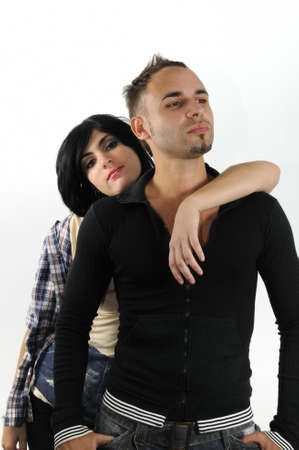 Portrait of young hispanic couple posing isolated with attitude photo